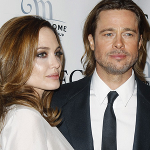 Brad Pitt and Angelina Jolie at a NYC corporate event at Metronome venue.